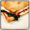 Fried Egg, Sriracha, Cream Cheese, and Spinach on Ciabatta