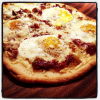 Sunny Side Up Egg, Prosciutto, and Caramelized Onion Pizza